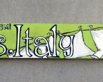 Hand painted and lettered City signs with 3-4 landmarks on recycled pallet boards