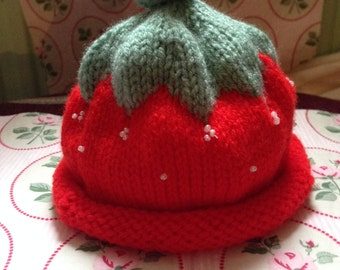 Handmade knitted strawberry baby hat