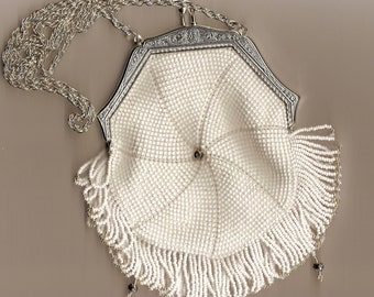 The Sierra, a bead crocheted vintage replica purse with frame and fringe
