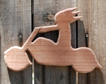 Wooden Cut Out Of A Motorcycle With Rider