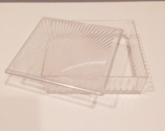 Vintage clear plastic container with lid