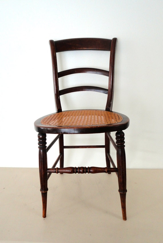 antique wooden chair caned seat spindled chair with a wicker seat