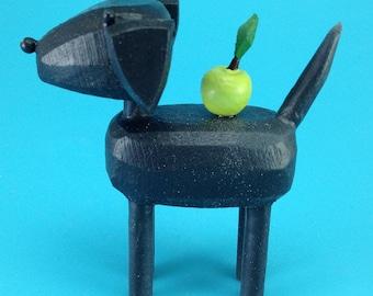 Black lab with apple