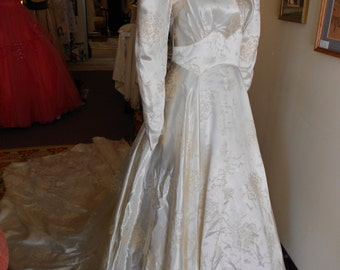 "1940, 32"" bust, pearl colored, embossed slipper satin, back trained wedding gown"