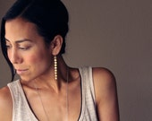 """Long and modern brass earrings of 9 connected brass discs named after Goddesses of Art and Literature - """"Brass Muse Earrings"""""""