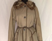 1970s Tan Raincoat with Fox Fur Collar. Metal Toggle Buttons. Matching Belt. Fully Lined. Size Large. From Glenoit, by RainCheetahs by Naman