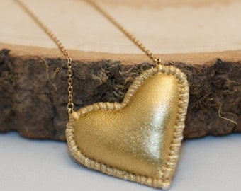 Gold heart - stitched faux leather stuffie necklace - on gold coloured chain
