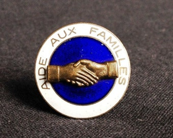 Nice to meet you. Antique shaking hands Help to Families enamel pin.