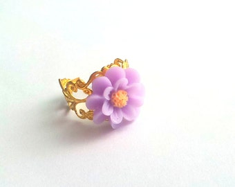Lila Colored  resin cabochon daisy ring atop gold plated adjustable metal  filigree, christmas