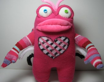 HUG BUG  is a luv bug. She's a pink sock toy that is all heart. A perfect valentine to give or to keep.