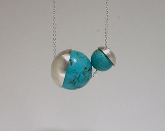 Two turquoise-colored beads and sterling silver necklace