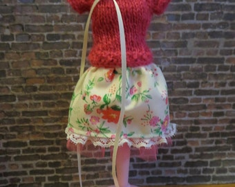 Pink sweater and creamy flower patterned skirt with tulle underskirt
