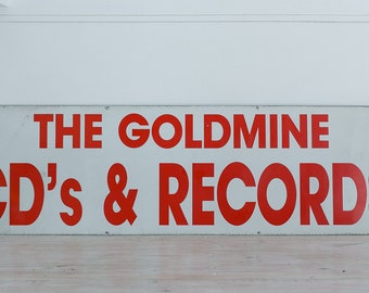 the goldmine cd's & records vintage metal sign