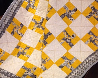 "Whirlygigs In Yellow, Grey and White All Together In This 34.5"" X 39.5"" Quilt"
