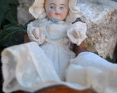 Exqusite Antique German All Bisque Jointed Baby Boy Doll in Original Christening Gown with Booties and Bonnet