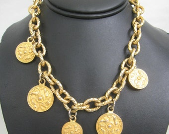 Vintage Salvatore Ferragamo statement necklace with golden round coin charms of shoes and chain. Gorgeous jewelry