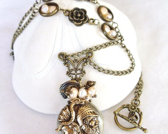 Art Nouveau pocket watch pendant with fresh water pearls and rose accents.