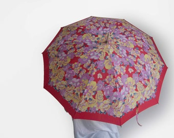 Vintage umbrella with red, pink, yellow and blue flower pattern