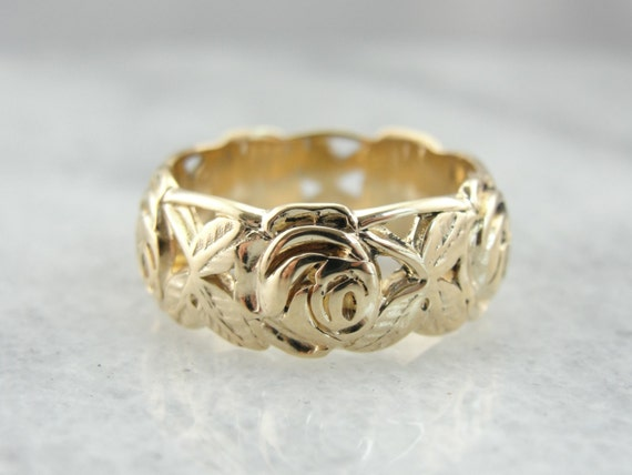 reserved carved and filigree floral motif wedding band in
