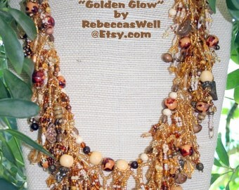 GOLDEN GLOW A luxuriously fringed beaded necklace...You will just LOVE to run your fingers thru this!