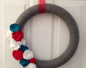 Gray yarn wreath with felt flowers