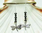 Dragonfly earrings; hematite earrings; silver dragonfly charm; hematite jewelry; dragonfly jewelry; nature theme earring; dark gray earrings
