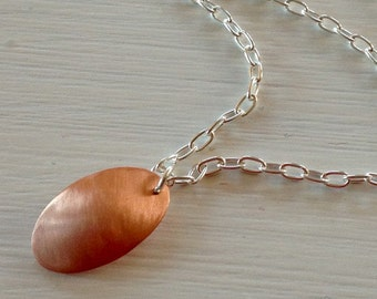Brushed copper and sterling silver necklace.  Convex oval copper. Modern. Contemporary