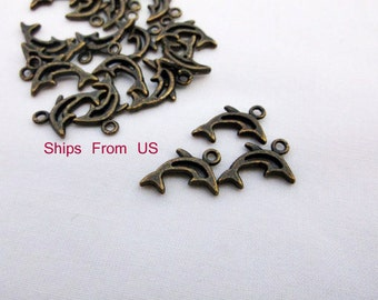 Bronze Tibetan hollow dolphin charms 12 charms
