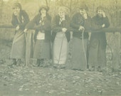 Women in the Woods Leaning on Fence Post Holding Walking Sticks RPPC Antique Real Photo Postcard Vintage Black and White Photo Photograph