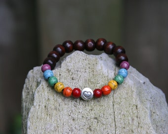 Yogi inspired wood bead rainbow chakra mala bracelet with heart or survivor ribbon charm bead for men or women