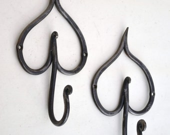 hand forged metal 'leaf' hook. 21cm tall,  11.5cm wide,  6.5cm deep (distance from hook tip to back)