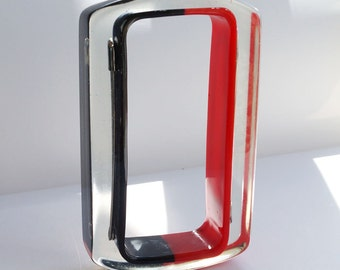 Red and black rectangular lucite bracelet with safety pins