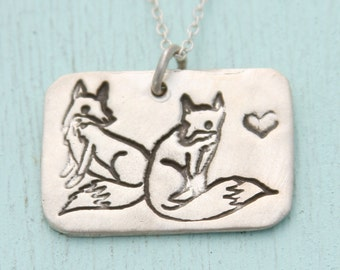 FOXES and heart necklace, eco-friendly sterling silver or white bronze.  Artwork by Boygirlparty. Handcrafted by Chocolate and Steel