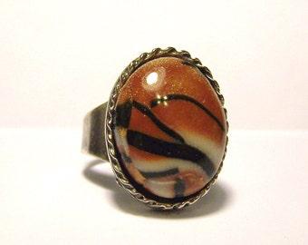 Oval tiger print adjustable band ring