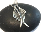 Black swan sterling silver wing necklace