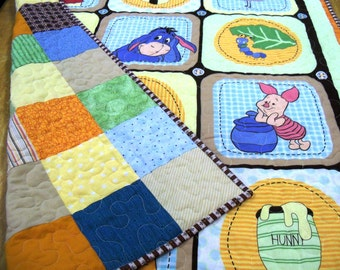 Baby boy patchwork quilt with winnie the pooh backing in browns blues and orange