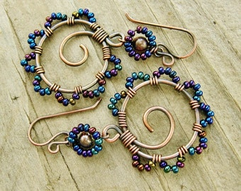 Bead Dance earrings in Iris Blue seed bead mix - wire wrapped antiqued copper hoops with seed beaded petals