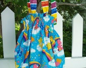My Carrie Girl's Sunsuit Bubble Romper made with Care Bears Rainbow fabric