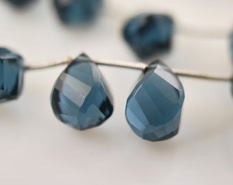 1/2 strand of blue quartz twisted drops  WHOLESALE PRICES 20.00