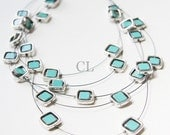 Turquoise Framed in Silver Necklace - turquoise glass beads in silver metal frames floating on black wire (N8)