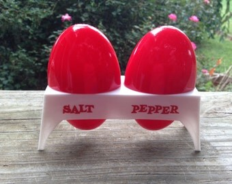 Set of Vintage Red and White Plastic Egg Shaped Salt and Pepper Shakers with Holder
