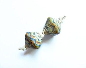 RAKU RIVER INK    2 ivory, silver, ink blue and raku tumbled crystal pair   A Beaded Gift