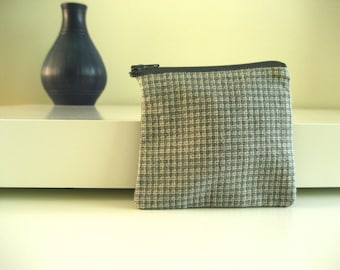 Olive, grey, white checkered purse with red lining