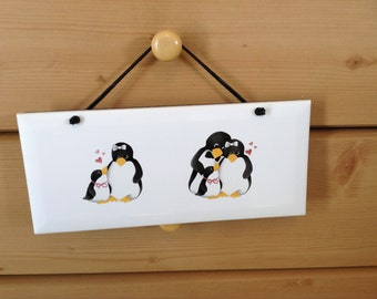 Ceramic Plaque  it is 4 1/4 by 10 With Cute Penguin's