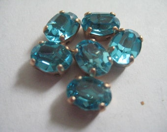 Lot of 6 8x6mm Aqua Oval Swarovski Rhinestones in Brass Sew On settings