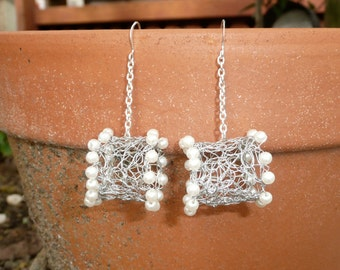 Lucky U - Signature crochet wire earrings in silver artistic wire and pearls.