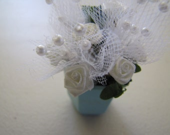 Dollhouse miniature floral arrangement white roses in turquoise pot.