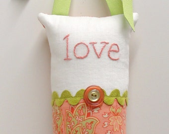 "love pillow- hand embroidered doorknob pillow ""love"" in coral on ivory linen and coral paisley print-  ready to ship"