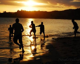 Sunset in Fiji with silhouette photo, beach football players, sepia sun photo, sunset reflections dusk Fijian beach photo, beach rugby print