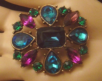 Fab brooch with blue,green and purple glass stones